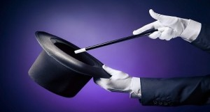 A photo of a magician's gloved hands holding a top hat and a wand