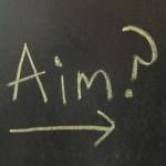Chalkboard with word aim written on it