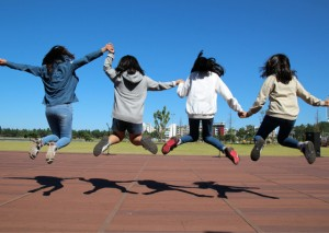 Communicate kids jumping for joy