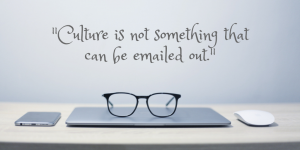 Photo of a laptop with the words Culture is not something that can be emailed out