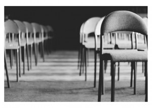 Photo of rows of empty chairs in a room
