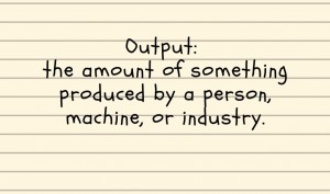 Handwritten note saying Output: the amount of something produced by a person, machine, or industry.