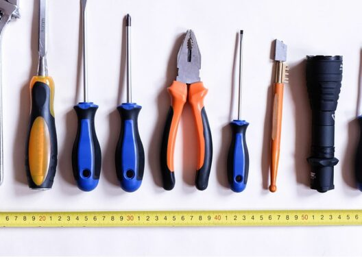 A row of tools, such as screw driver and pliers, ready to be put in a communication toolkit
